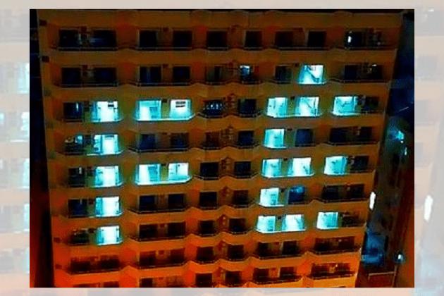 """Hotel em Balneário Camboriú acende a palavra """"FÉ"""" todas as noites para apoiar os moradores durante a pandemia"""